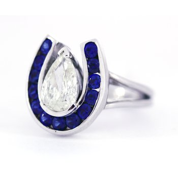 Diamond, Sapphire and White Gold Horseshoe Ring