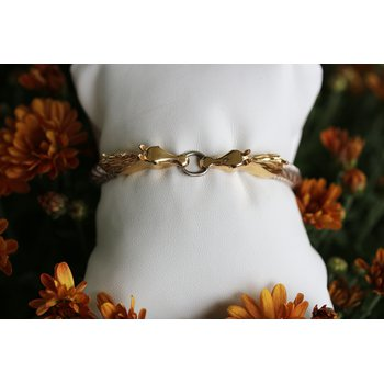Two tone, sterling silver and yellow gold, kissing horse bracelet