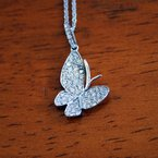 Signature Collection 18k White Gold Butterfly Pendant consisting of round brilliant Diamonds weighing an approximate total 0.37cts