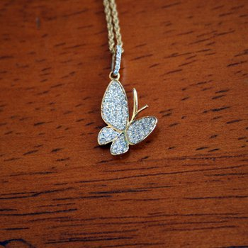 18k Yellow Gold Butterfly Pendant consisting of round brilliant Diamonds weighing an approximate total 0.40cts