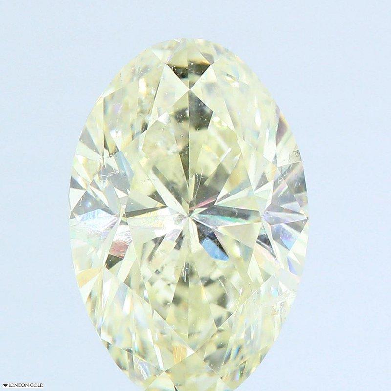 Colored Diamonds Oval 2.11 Light Yellow-SI1 Clarity Enhanced