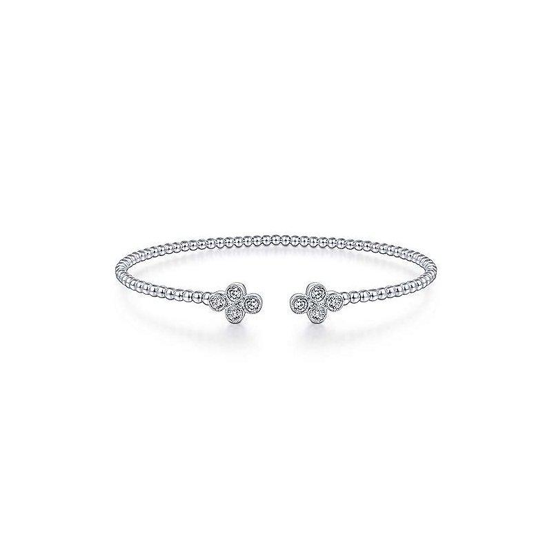 Gabriel Fashion Sophisticated diamond motifs  accent this golden Bujukan bangle.
