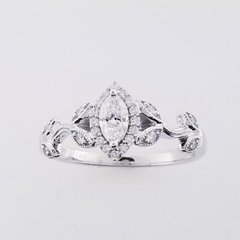 .38 Marquise diamond ring SI/GH 14KW